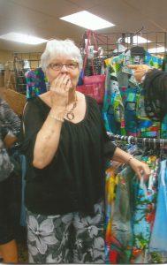 Sally Dittman looking at clothing