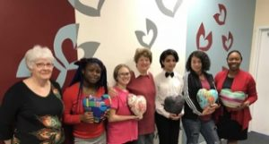 picture of PACE girls with heart pillows